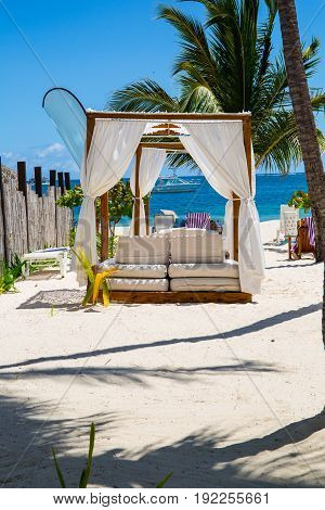 Relax on a luxury VIP beach with nice pavilion in sunshine blue sky day