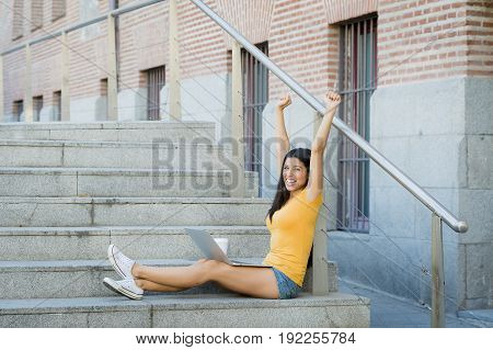 Attractive Latin Woman Working On Her Laptop