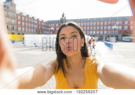 Attractive Latin Woman Talking Selfie