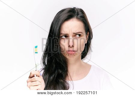Dentistry, toothbrush, girl on isolated background, girl holding toothbrush, girl on white background.