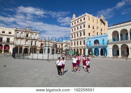 Havana Cuba - February 2 2017: Old colonial buildings on Plaza Vieja square in Havana Vieja.UNESCO wold heritage site Habana Vieja is a preserved slice of Cuban history. Grand Baroque and neoclassical buildings show what life in Cuba in the past century.