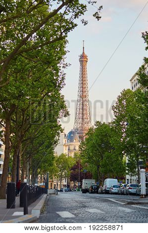 Parisian street with Eiffel tower seen at the end