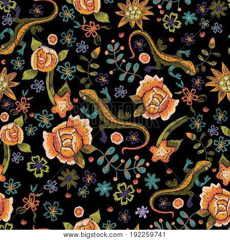 Embroidery ethnic seamless pattern with lizards and flowers. Vector embroidered floral design for fashion.