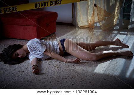 Crime scene. Victim lying on the floor