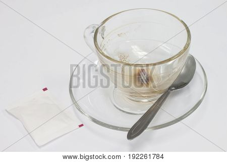 Dink coffee with sugar and spoon on white background.The drink is gone