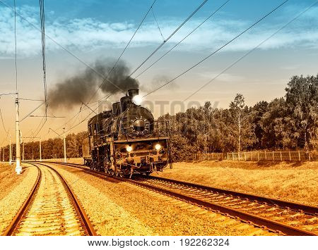 Steam train moves toward in the Moscow region.