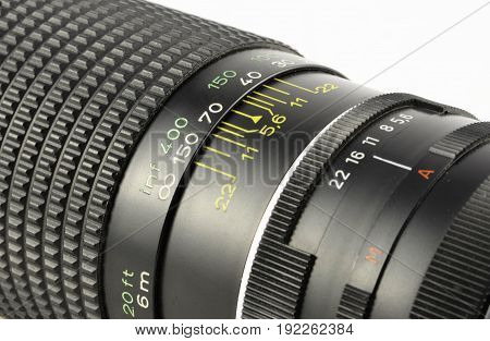 close up image of photographic lens on white background