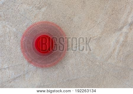 Red Fidget Spinner Stress Relieving Toy On Wooden Background