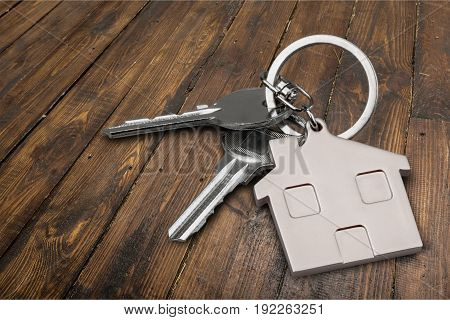 Key silver home badge table background nobody