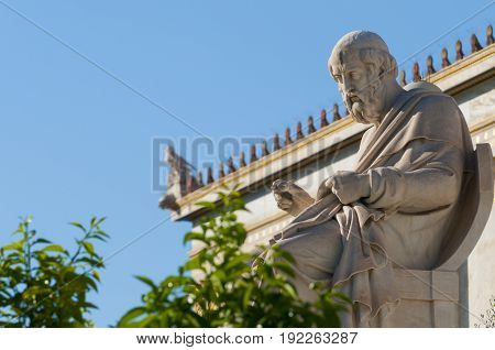 classic statues Plato sitting, under blue sky