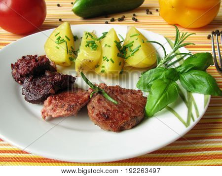 Jacket potatoes with red and liver sausage