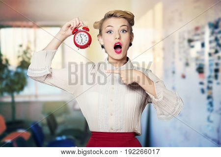 Clock woman alarm shocked young adult red background