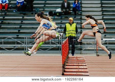 Chelyabinsk Russia - June 4 2017: women running race in 100 meter hurdles during UrFO Championship in athletics