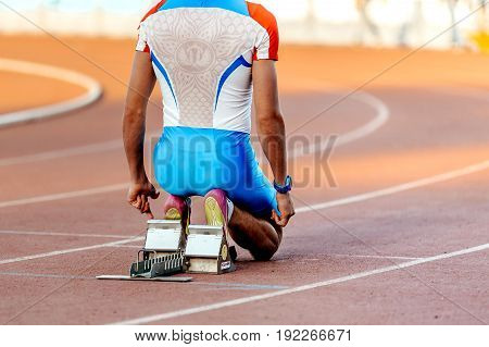 Chelyabinsk Russia - June 4 2017: russian national team male runner at start for sprint race during UrFO Championship in athletics