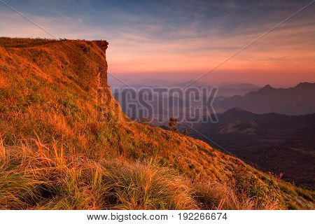 Sunset Scene With The Peak Of Mountain And Cloudscape At Phu Chi Fa In Chiang Rai, Thailand