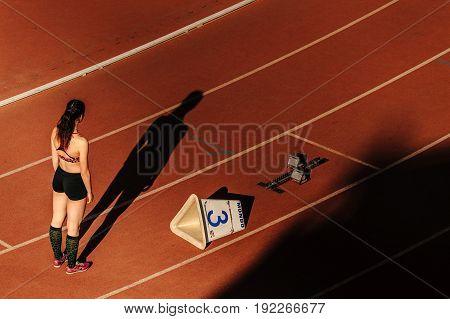 Chelyabinsk Russia - June 4 2017: shadow girl runner start race of 400 meters during UrFO Championship in athletics