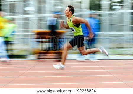 Chelyabinsk Russia - June 4 2017: blurred motion sprinter runner running man race in 200 meters during UrFO Championship in athletics