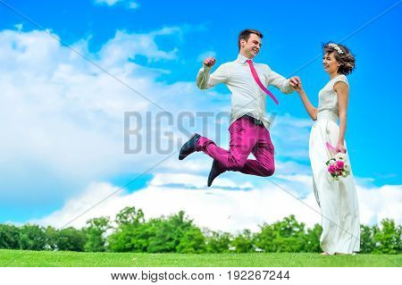 Happiness Is In Her Hands: Young And Handsome Bridegroom Is Fluttering In The Air. Purpul Pants