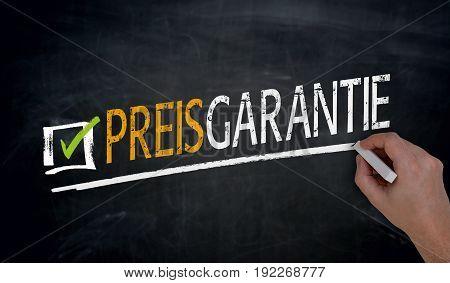 Preisgarantie (in german price guarantee) is written by hand on blackboard.