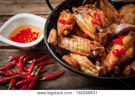 Deep fried chicken wings with red hot chili pepper oil