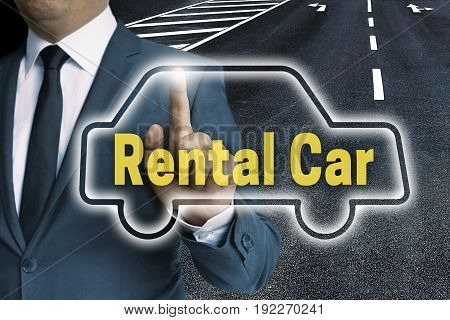 Rental Car Auto Touchscreen Is Operated By Business Man Concept