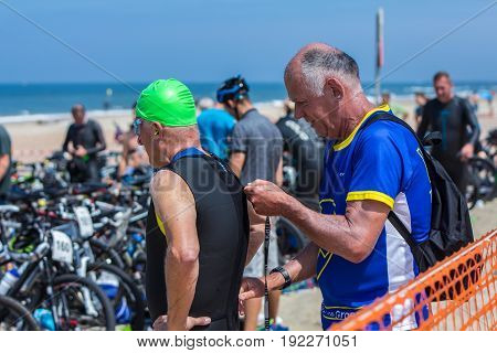 Kijkduin The Hague the Netherlands - 17 June 2017: Kijkduin cross triathlon senior participant about to do swim leg