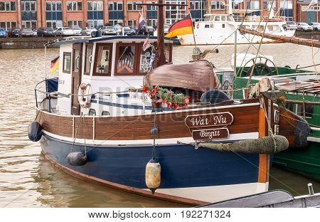 Leer, Germany - December 8, 2014: Ancient boats moored in the marina. The exposure to the public is free to visiting tourists.