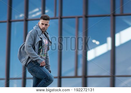 Young stylish attractive man in urban background in the city
