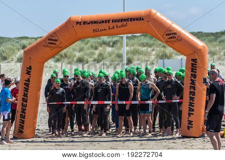 Kijkduin The Hague the Netherlands - 17 June 2017: Kijkduin cross triathlon athletes ready at startline