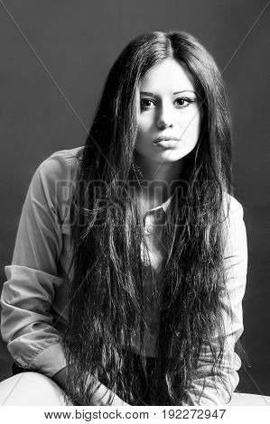 fashion portrait of a young girl in black and white