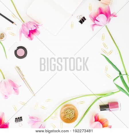 Home feminine workspace with clipboard, notebook, pink flowers and accessories on white background. Flat lay, top view. Blogger or freelancer concept