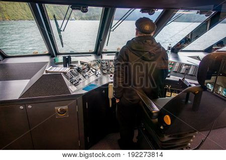 SOUTH ISLAND, NEW ZEALAND- MAY 25, 2017: Close up of a ferry boat with a captain in the command cabin controling the ferry, in south island, new zealand.