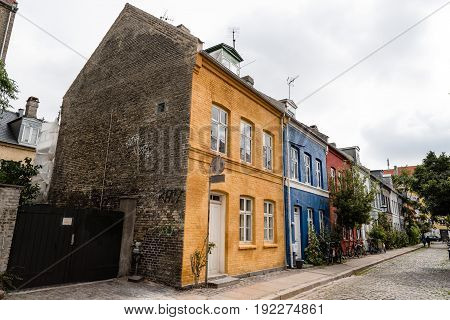 Copenhagen Denmark - August 12 2016. Picturesque old brick colorful houses in historical city centre of Copenhagen a cloudy day of summer