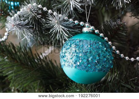 many beautiful decorations on the Christmas tree