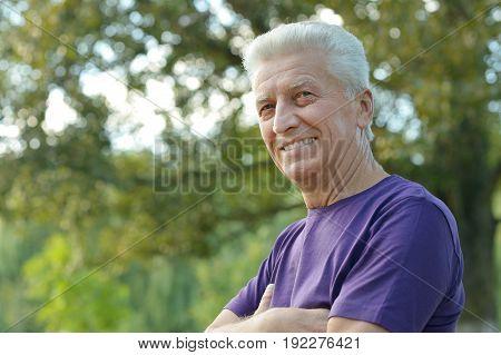 Close up portrait of senior man outdoors