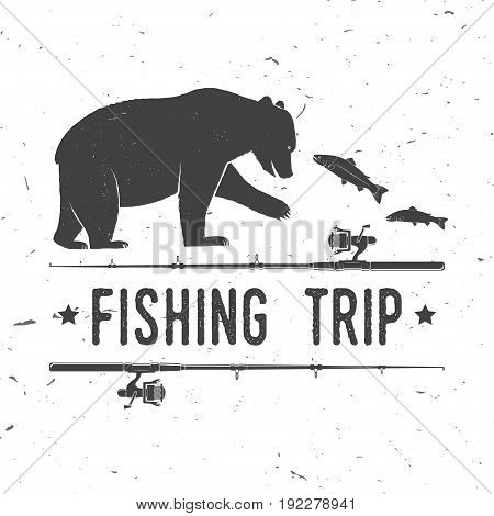 Fishing trip. Vector illustration. Concept for shirt or logo, print, stamp or tee. Vintage typography design with bear and salmon silhouette.
