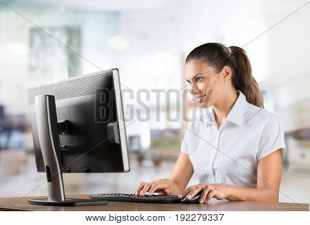 Young attractive woman using technology computer.