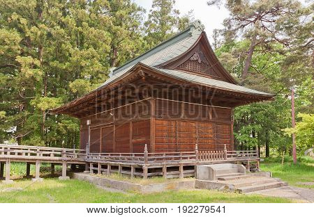 HIROSAKI JAPAN - MAY 23 2017: Honden Hall of Gokoku Shinto Shrine in Hirosaki Castle Japan. Shrine was founded in 1870 by Tsugaru Tsuguakira the 12th and final lord of Hirosaki Domain