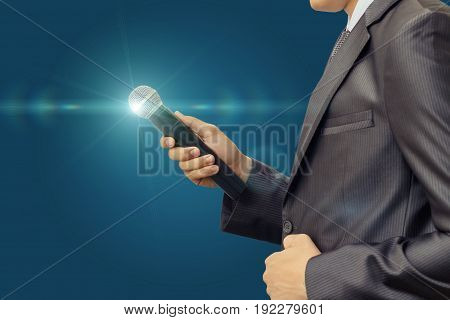 Businessman With A Microphone.