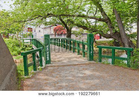HIROSAKI JAPAN - MAY 23 2017: Ichiyo-bashi Bridge of Hirosaki Castle Japan. Castle was erected by Tsugaru Nobuhira in 1611 designated National Historic Site in 1952