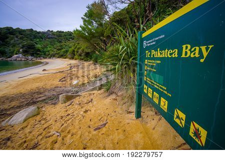 SOUTH ISLAND, NEW ZEALAND- MAY 22, 2017: Informative sign in the beach in Abel Tasman National Park located in South Island in New Zealand.