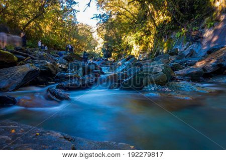 SOUTH ISLAND, NEW ZEALAND- MAY 23, 2017: Long Exposure image of a Waterfall in Lush Temperate Rainforest on the West Coast of New Zealand.