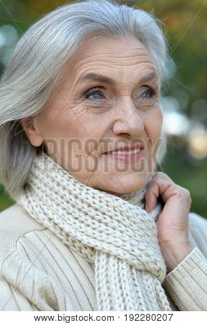 Portrait of a senior beautiful woman posing outdoors