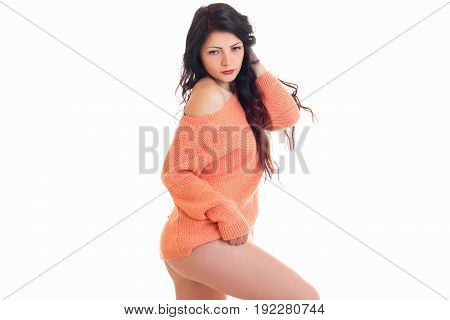 pretty young brunette woman only in pink sweater isolated on white background