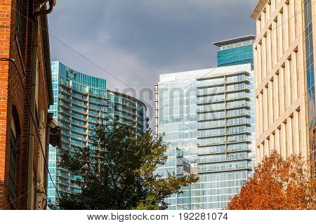 Group of skyscrapers with glass facades in Midtown Atlanta in cloudy day USA