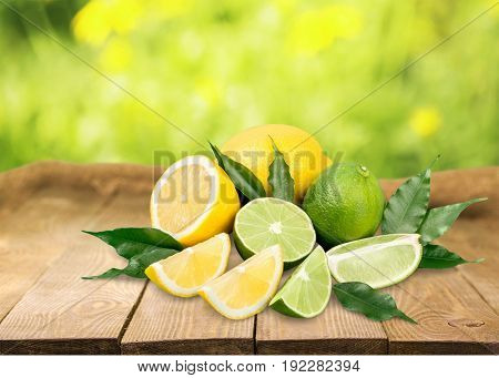 Fresh lemons limes on table green and yellow colors