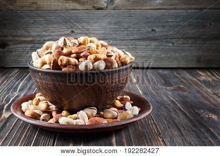 Nuts Set In Bowl Almonds, Pistachios, Cashews, Peanuts, Vintage Wooden Background