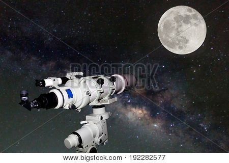 Telescope watching the Milky Way galaxy and Full moon on dark night at thailand