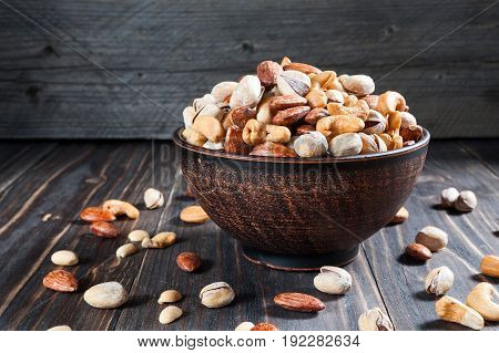 Healthy Mix Nuts On Wooden Background. Almonds, Cashews, Peanuts