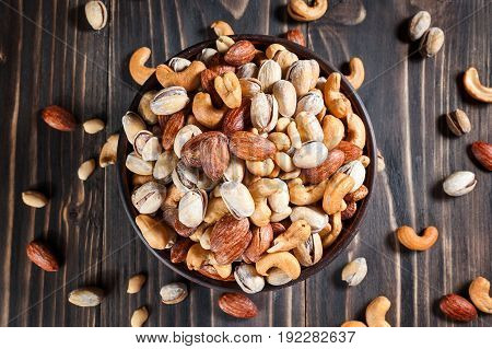 Mixed Nuts On Dark Background. Healthy Food And Snack.
